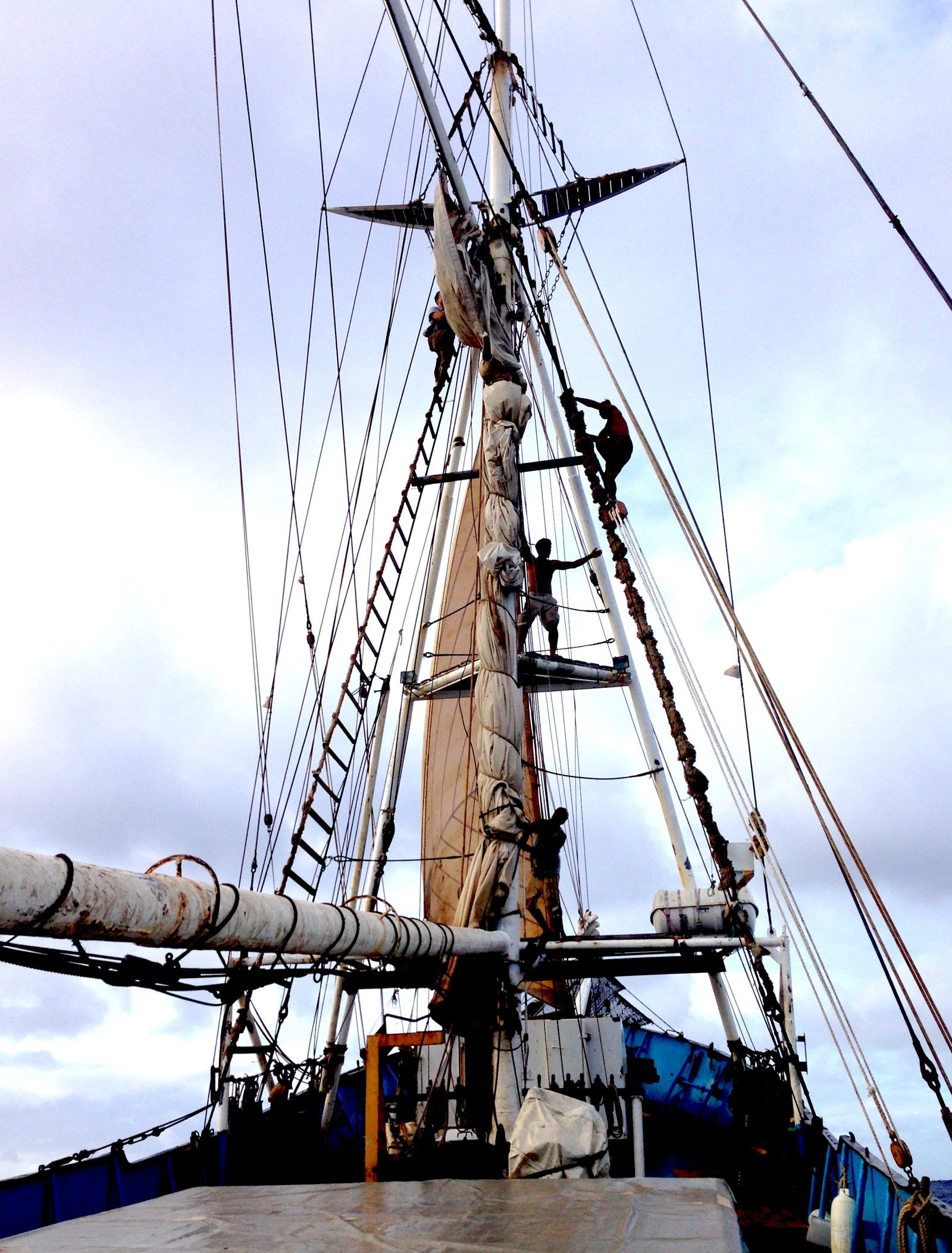 Furling the sail on the SV Kwai